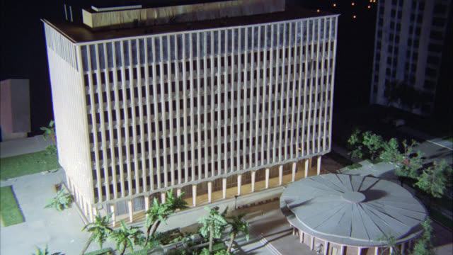 high angle down miniature model of high rises apartment or hotel building and circular domed theater building. cities. palm trees visible. gazebo visible. series. - gazebo stock videos & royalty-free footage