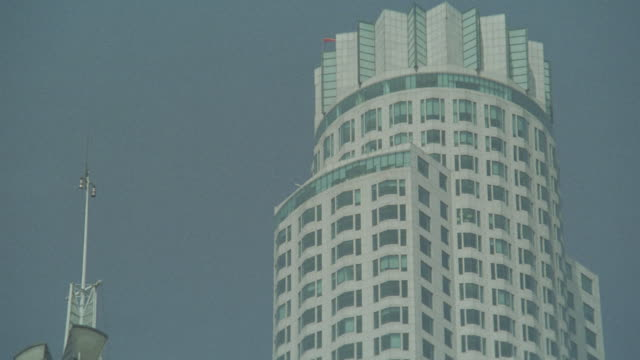 up angle of us bank tower or library tower in downtown los angeles. office buildings, skyscrapers. - us bank tower stock videos & royalty-free footage