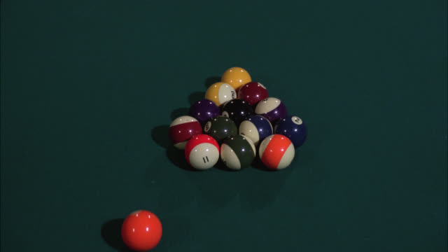 close angle of pool table. billiard balls. game being played. rack broken and balls scatter. series. - pool table stock videos & royalty-free footage