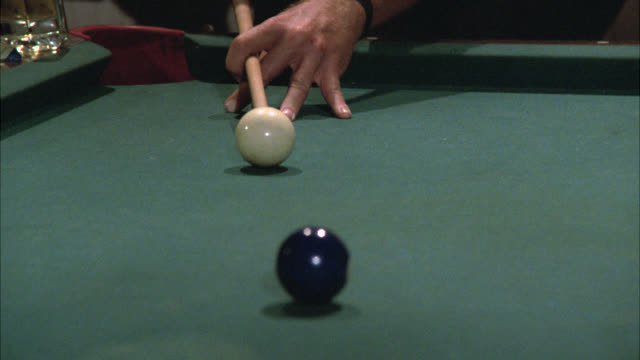 close angle of people playing game of billiards on pool tables. billiards balls. - pool table stock videos & royalty-free footage