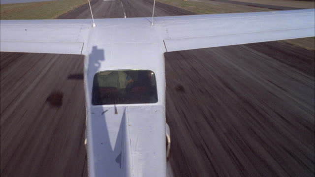 medium angle pov from tail of plane.    take off single engine airplane. runways. - airplane tail stock videos and b-roll footage