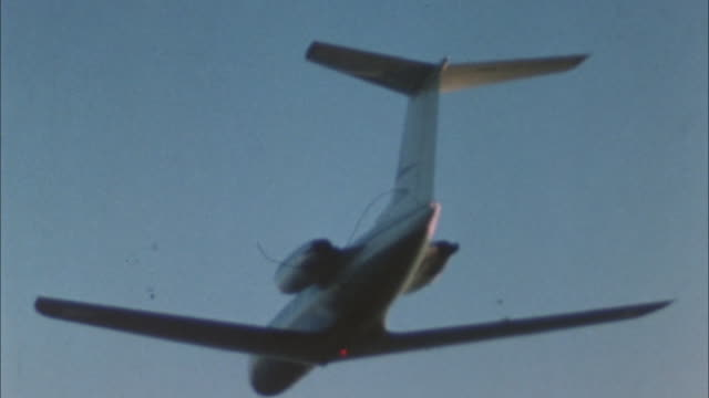 aerial air-to-air shot of corporate jet lear jet flying in flight clouds in bg  flashing light on bottom of plane. private jets. airplanes. - air to air shot stock videos & royalty-free footage
