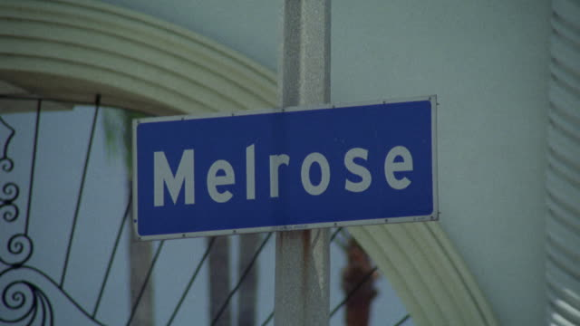 "close angle of street sign ""melrose"" avenue. in front of entrance gate to paramount pictures studios. - paramount pictures stock videos & royalty-free footage"