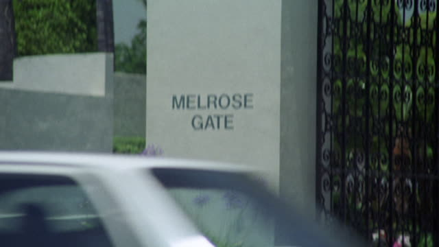 "pan up from ""melrose gate"" sign to ""paramount pictures"" sign above gate. - paramount pictures stock videos & royalty-free footage"