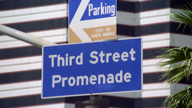 "pan left to right from a pole with 2 signs "" parking, city of santa monica"" and ""third street promenade"" to the actual promenade. shopping area or center. see shops, stores, restaurants, people and trees. los angeles area. - santa monica street stock videos & royalty-free footage"