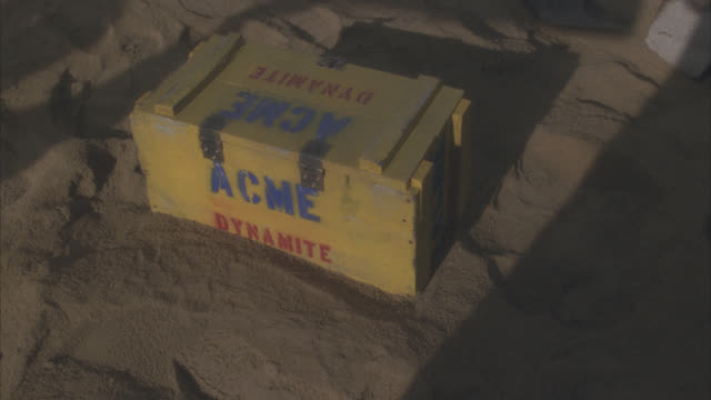 "close angle of yellow wooden box with ""acme dynamite"" written on it. - explosive stock videos & royalty-free footage"