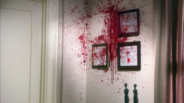 medium angle of blood and gore on wall with framed diplomas. could be doctor's office or dentist's office. picture frame missing from wall. could be murder crime scene. - gore stock videos & royalty-free footage