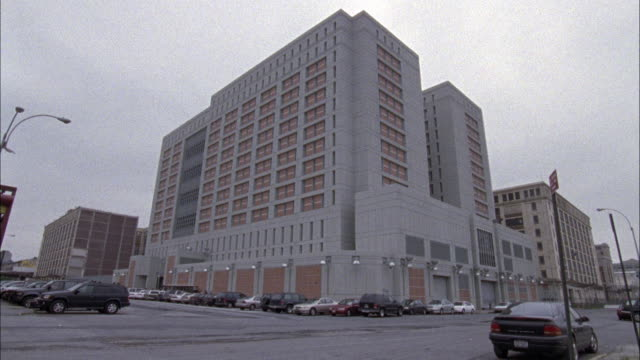 wide angle of the justice federal bureau of prisons brick building, then zooms in closer. - federal building stock videos and b-roll footage
