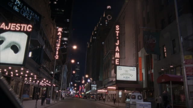 wide angle. camera mounted inside car looking through windshield. driving down city street on broadway. shaky. see majestic, st. james and helen hayes theaters. - broadway manhattan stock-videos und b-roll-filmmaterial