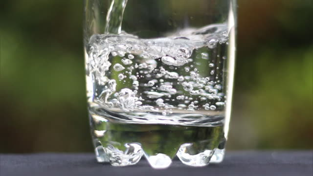 pouring water in glass - drinking water stock videos & royalty-free footage