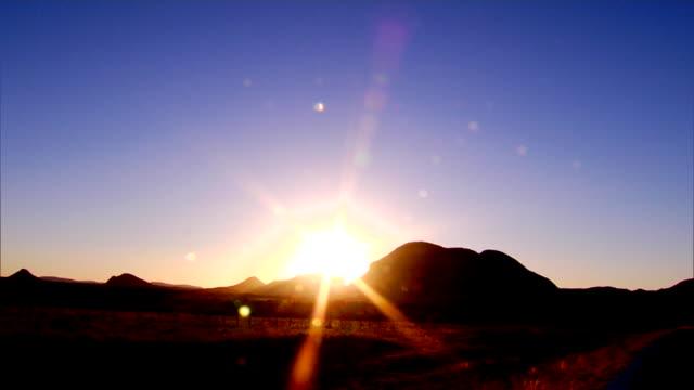 sunrise behind mountains - morgendämmerung stock-videos und b-roll-filmmaterial