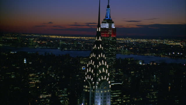 aerial of new york city skyline. see chrysler building and empire state building. see hudson river  in bg. see skyscrapers and high rise buildings. rotates around chrysler building to show met life building and others in bg in city skyline. - chrysler building stock videos & royalty-free footage