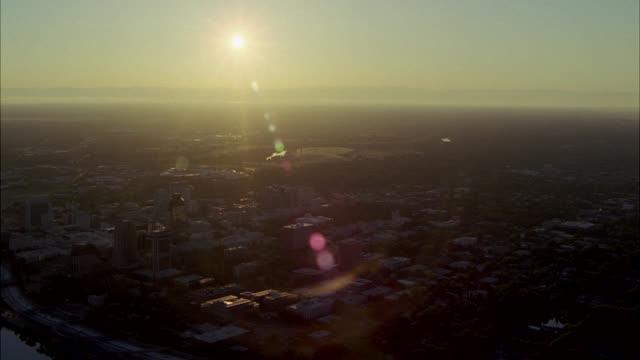 aerial of sacramento city skyline at sunset. sacramento river in bg. high rises and office buildings. - sacramento stock videos & royalty-free footage