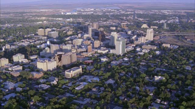 aerial of sacramento city skyline. high rises and office buildings. trees. - sacramento stock videos & royalty-free footage