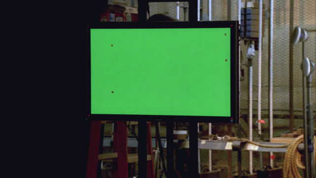medium angle of flat-screen television monitor, green screen. backstage, could be in theater or studio. burn-in. - backstage stock videos & royalty-free footage
