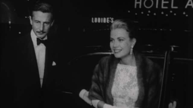 1950s b/w cu grace kelly exiting luxury car / los angeles california usa - grace kelly actress stock videos & royalty-free footage
