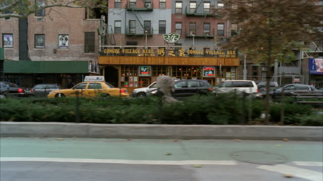 process plate straight left driving on city street through urban area. allen street, could be chinatown, lower east side of manhattan. cars and trucks. multi-story and high rise brick office or apartment buildings. - moving process plate stock videos & royalty-free footage