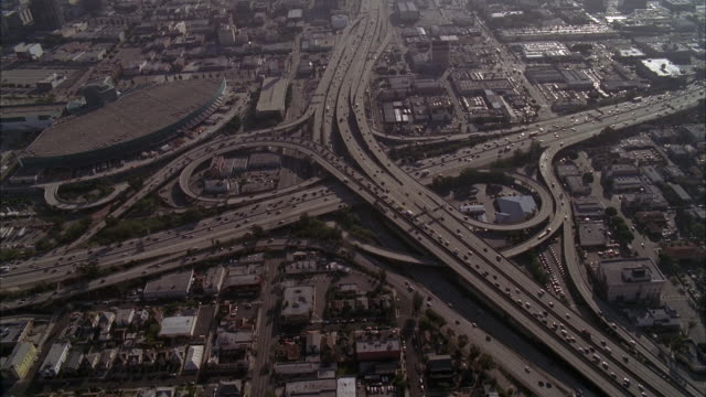 AERIAL OVER LOS ANGELES 110 FREEWAY AND CONVENTION CENTER. CARS DRIVING OF FREEWAY OR HIGHWAY. CITIES.