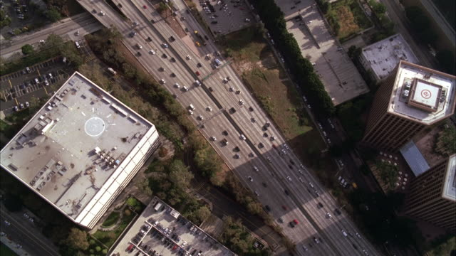 AERIAL OVER LOS ANGELES 110 FREEWAY  CARS DRIVING OF FREEWAY OR HIGHWAY. CITIES