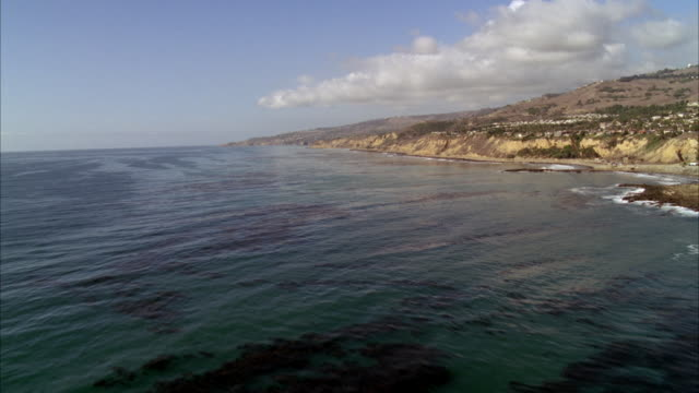aerial of pacific coast. beach and shore visible. palos verdes. could play for malibu. house and condominiums visible. cliffs or bluffs visible. - holiday villa stock videos & royalty-free footage