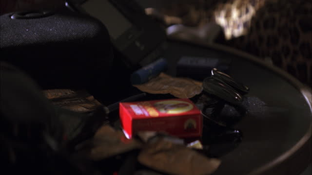 close angle of box of raisins, sunglasses, condoms on nightstand. messy. - imperfection stock videos & royalty-free footage