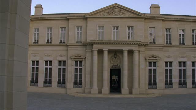 pan up of the fleur de lys mansion. upper class two story house, stone building. los angeles area. - fleur de lys stock videos & royalty-free footage