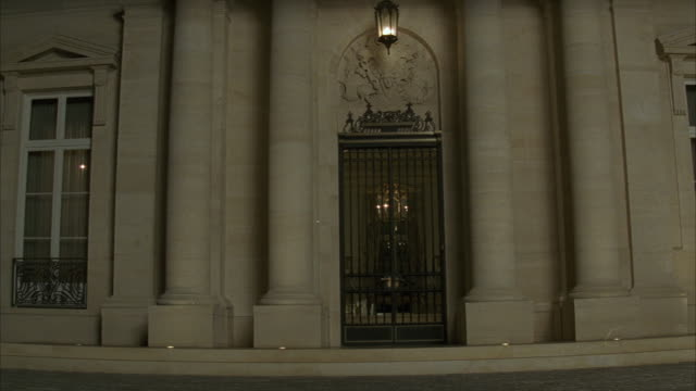 medium angle of entrance to fleur de lys mansion. upper class stone house. iron gate. los angeles area. - fleur de lys stock videos & royalty-free footage