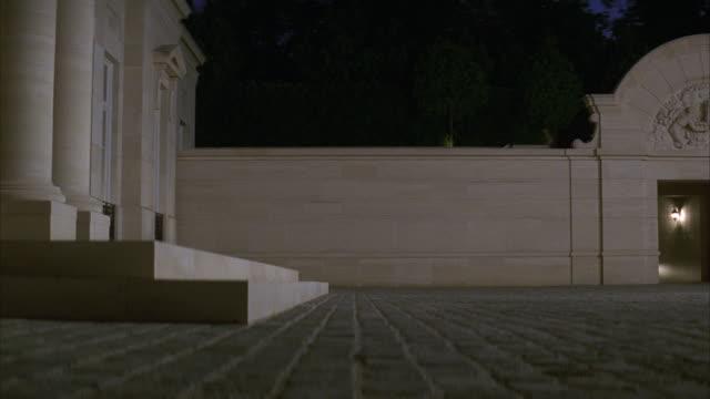 medium angle of garage entrance and courtyard at fleur de lys mansion. upper class. los angeles area. - fleur de lys stock videos & royalty-free footage