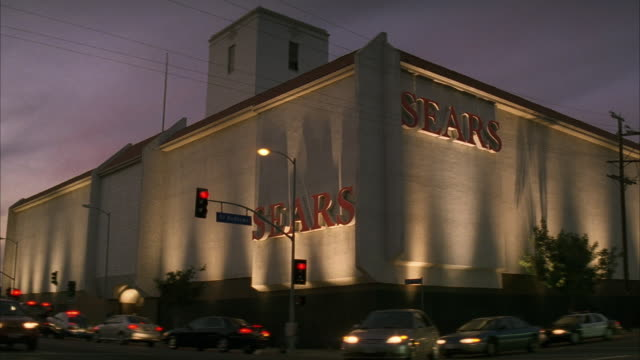 wide angle of sears department store on st. andrews and santa monica blvd. cars driving through intersection. - santa monica blvd stock videos & royalty-free footage