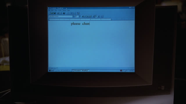 "close angle of child's hand typing on computer keyboard. camera pans up to computer monitor. text reads ""please change the shape of the table you are."" - vintage computer monitor stock videos & royalty-free footage"
