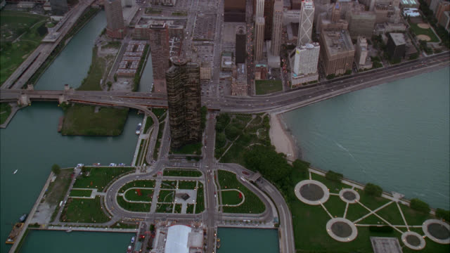 aerial of chicago skyline. high rises building and skyscrapers along coast. john hancock tower and sears or willis tower visible. downtowns. chicago river and lake shore bridge visible. navy pier on lake michigan visible. - great lakes stock videos & royalty-free footage