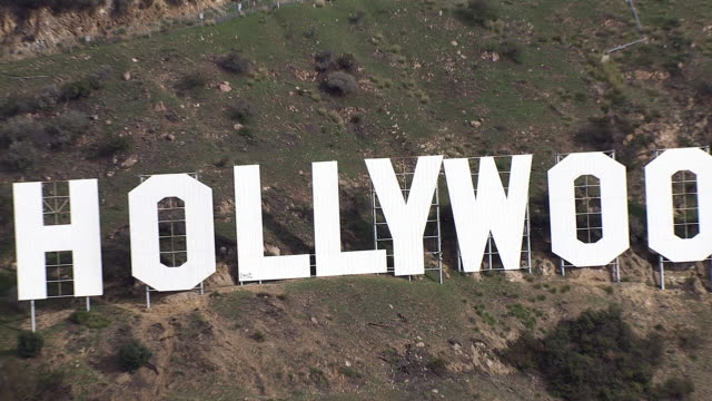 aerial of hollywood sign on mount lee in hollywood hills. radio antenna tower. landmarks. - hollywood sign stock videos & royalty-free footage