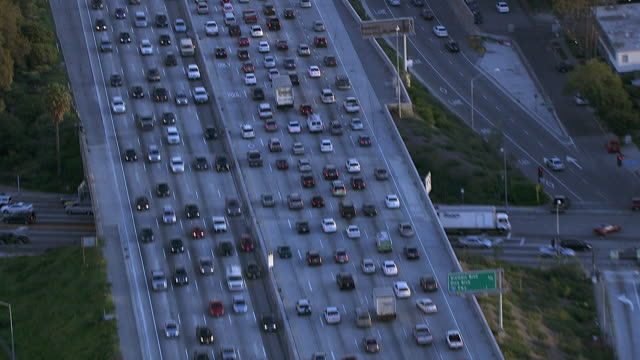 aerial of cars in traffic on interstate 405 freeway or highway. city. - traffic stock videos & royalty-free footage