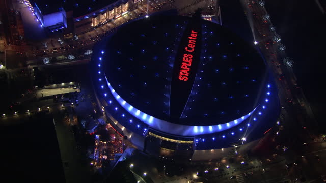 AERIAL OF STAPLES CENTER AND NOKIA THEATER IN DOWNTOWN. SPORTS ARENA. SPOTLIGHTS.