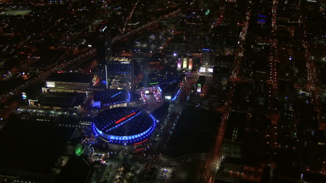 aerial of staples center and nokia theater in downtown. sports arena. spotlights. - staples center stock videos and b-roll footage