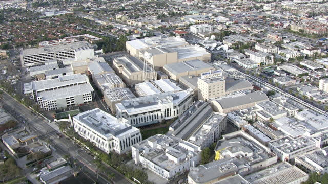 aerial of sony pictures studios lot. multi-story office buildings. sound stages. columbia pictures sign and billboard or advertisement. jeopardy. game shows. water tower. cities. los angeles area. - game show stock videos & royalty-free footage