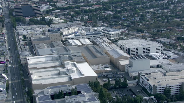 aerial of sony pictures studios lot. multi-story office buildings. sound stages. columbia pictures sign and billboard or advertisement. water tower. city streets. apartment buildings. parking garages. los angeles area. - culver city stock videos & royalty-free footage