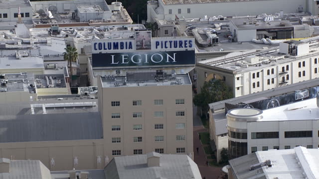 aerial of sony pictures studios lot. multi-story office buildings. sound stages. columbia pictures sign and billboard or advertisement. los angeles area. - culver city stock videos & royalty-free footage