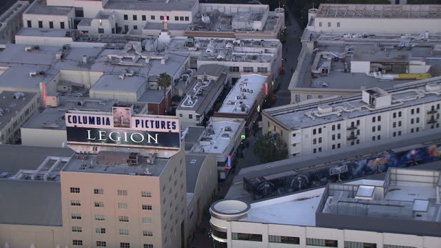 aerial of sony pictures studios lot. multi-story office buildings. sound stages. city streets. gate or entrance on culver blvd. columbia pictures sign and billboard or advertisement. water tower. los angeles area. - culver city stock videos & royalty-free footage