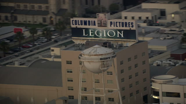 aerial of water tower on sony pictures studios lot. multi-story office buildings. sound stages. columbia pictures sign and billboard or advertisement. los angeles area. - culver city stock videos & royalty-free footage