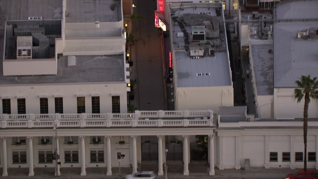aerial of colonnade on washington blvd. columns or pillars. sony pictures studios lot. multi-story office buildings. sound stages. neon signs. los angeles area. - culver city stock videos & royalty-free footage
