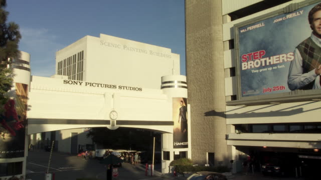 "pan left to right of movie billboards, signs or advertisements for ""stepbrothers"", ""the house bunny"" and ""pineapple express"" on overland parking garage. sony pictures studio lot. los angeles area. - culver city stock videos & royalty-free footage"