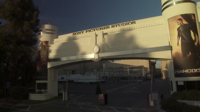 pan up of overland gate or entrance to sony pictures studio lot. security gates. los angeles area. - culver city stock videos & royalty-free footage
