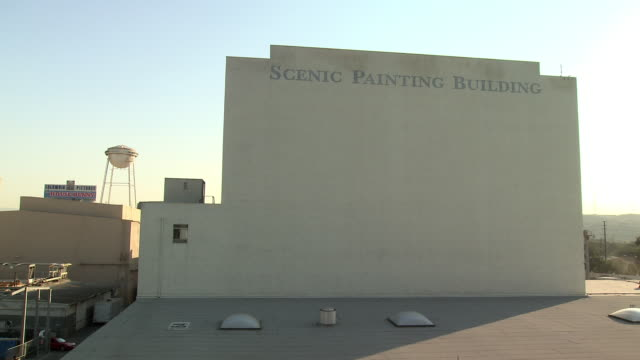 "wide angle of ""scenic painting building"" sign on multi-story building. water tower in bg. sony pictures studio lot. los angeles area. - culver city stock videos & royalty-free footage"