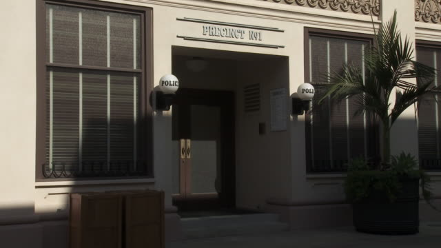 """WIDE ANGLE OF POLICE STATION """"PRECINCT NO. 1"""" ENTRANCE. MAIN STREET. SONY PICTURES STUDIO LOT. LOS ANGELES AREA."""