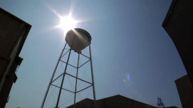 up angle of water tower at sony pictures studio lot. time lapse of sun moving across sky. movie studio. - culver city stock videos & royalty-free footage