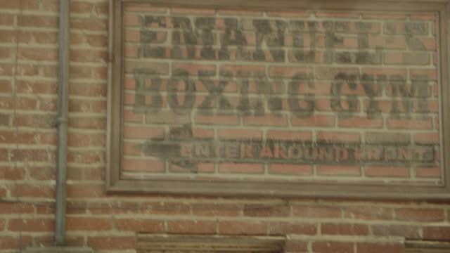 close angle of sign for boxing gym on brick building. - 2013年点の映像素材/bロール