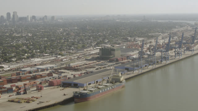 aerial of port or docks with cranes and shipping containters. industrial area along mississippi river. - river mississippi stock videos & royalty-free footage