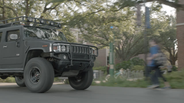 process plate 3/4 left back of hummer or suv driving through college campus or university. tulane university. - hummer stock videos and b-roll footage