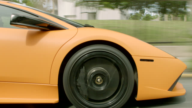 tracking shot of lamborghini, luxury sports car, driving on city street, swerving between cars, following jeep. could be part of car chase. car stunt. - sports car stock videos & royalty-free footage